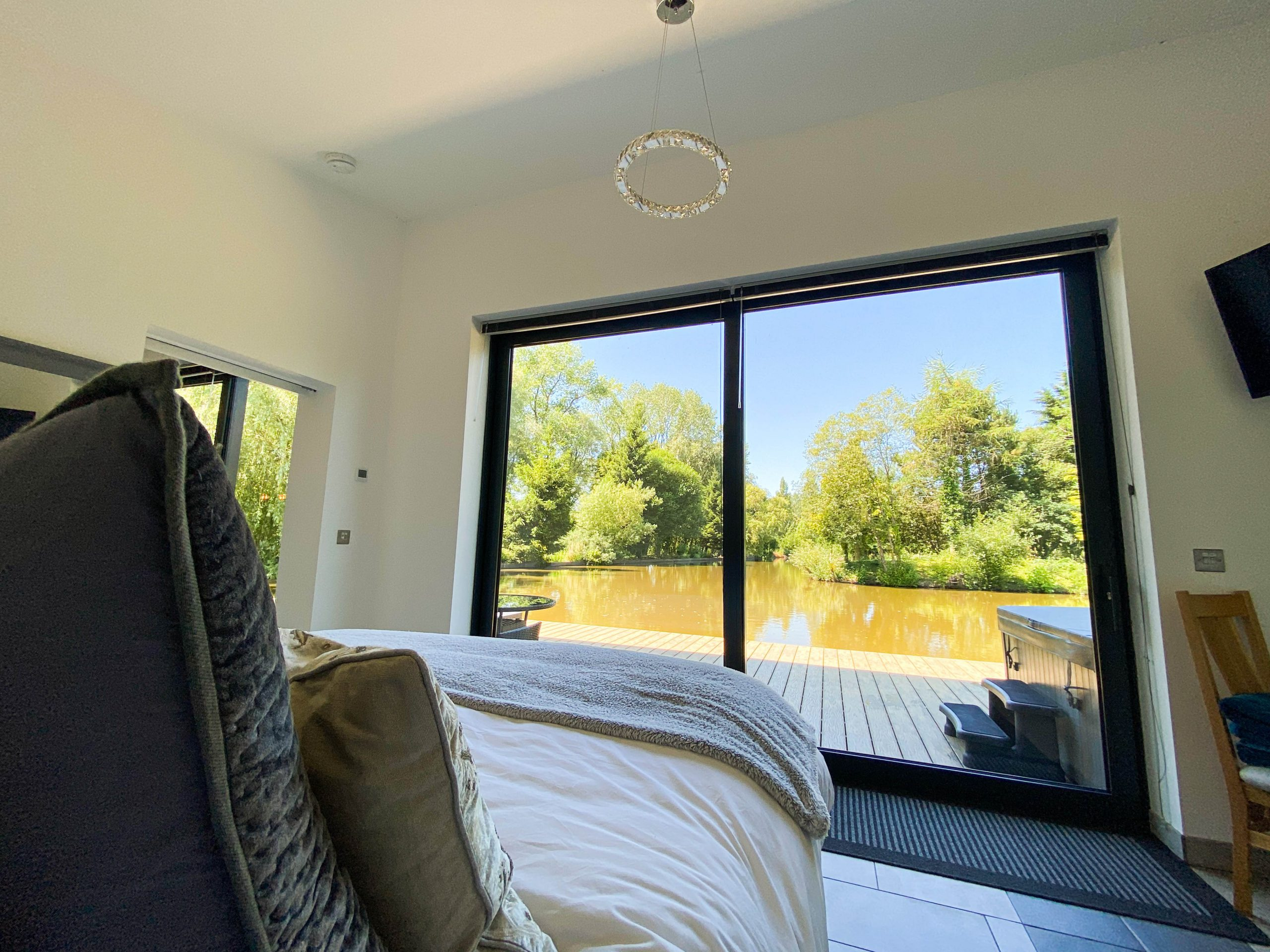Enjoy the beautiful surroundings of Woody Park from the comfort of your bed